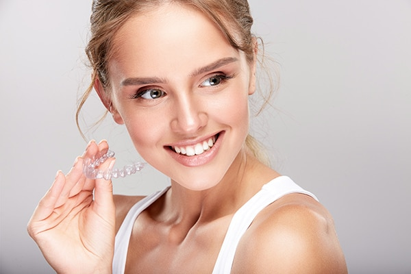 Woman with Invisalign image