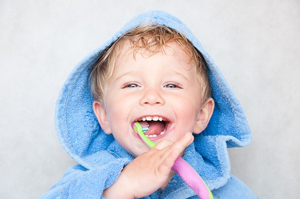 Young Boy Brushing Teeth image