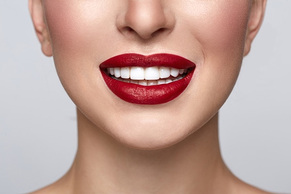 Woman with red lips smiling image